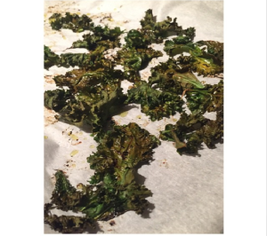 DELISH Kale Chips!!! And such a healthy snack! I LOVED the tangy taste to these! Here's the recipe! •1 or 2 TB olive oil •1 TB freshly squeezed lime juice •1 bunch kale •1/2 tsp sea salt Preheat oven 350 degrees. Line baking sheet with waxed or parchment paper. In small bowl, combine olive oil & lime juice and set aside. Rinse and dry kale thoroughly. (Be sure kale is dry, or you'll have have steamed or burned chips.) Remove kale stems and cut leaves into small pieces. Spread kale on the prepared baking sheet and drizzle oil/juice mixture. Bake for 10-12 mins or until crispy. Stay close to the oven because these can burn very quickly. Remove from oven and immediately sprinkle sea salt.